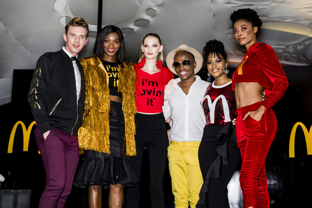 Models wearing the Big Mac range pose with Gert-Johan Coetzee, and McDonald's ambassadors Somizi Mhlongo and Nomzamo Mbatha. Photo: Nicole Laxton Photography