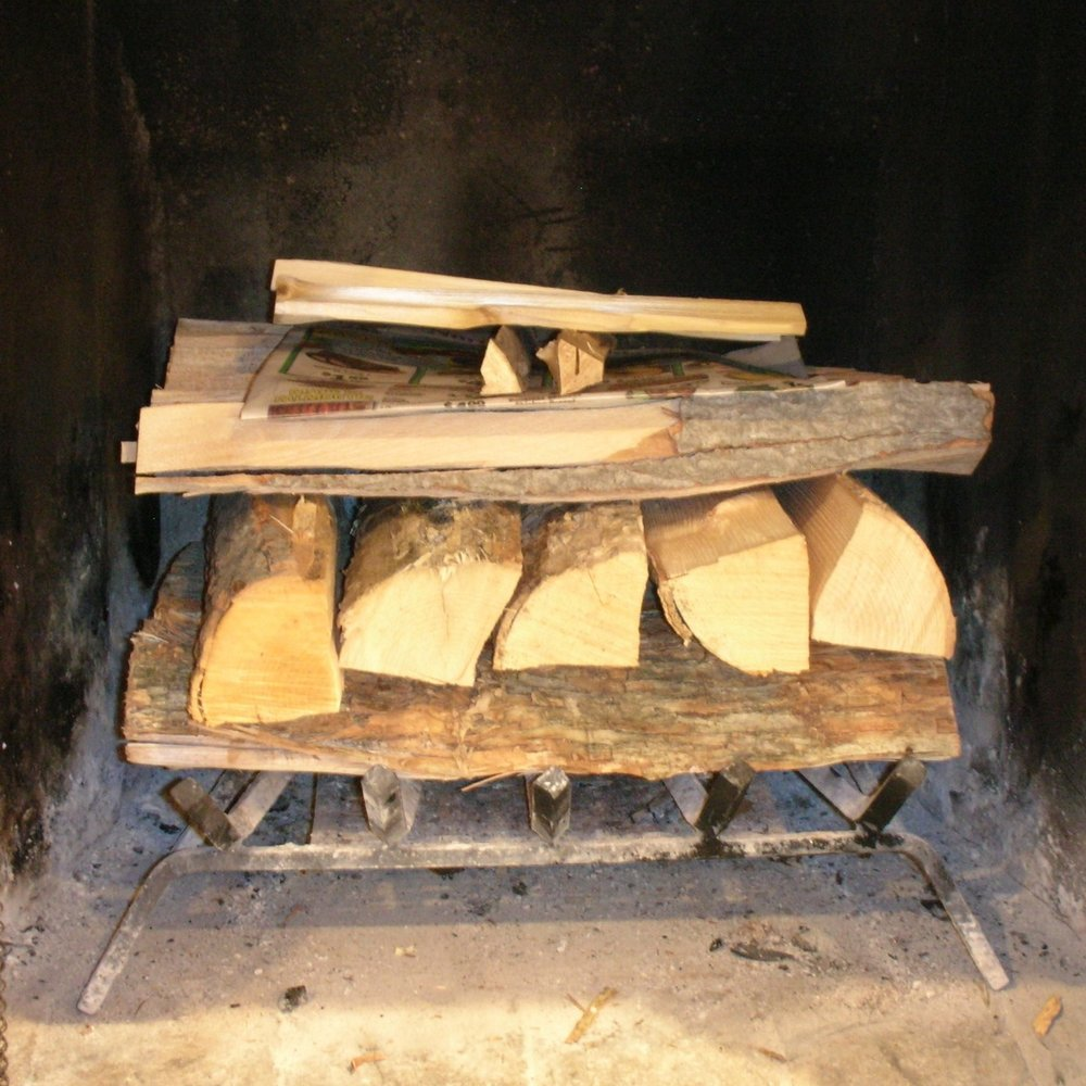 Step #2Build layers of small logs - Crisscross two or more layers of progressively smaller logs as you move up.