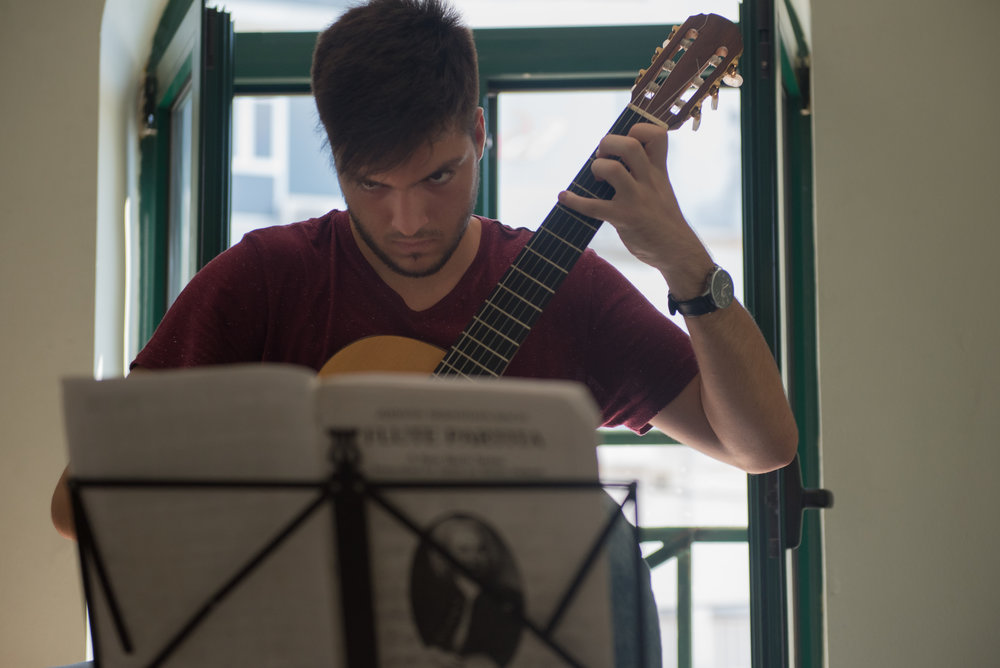 Lorik Pylla practices his guitar in the guitar classroom of the Prenk Jakova high school in Gjakova, Kosovo, July 10, 2017.  Pylla averages between three and four hours of practice time a day.