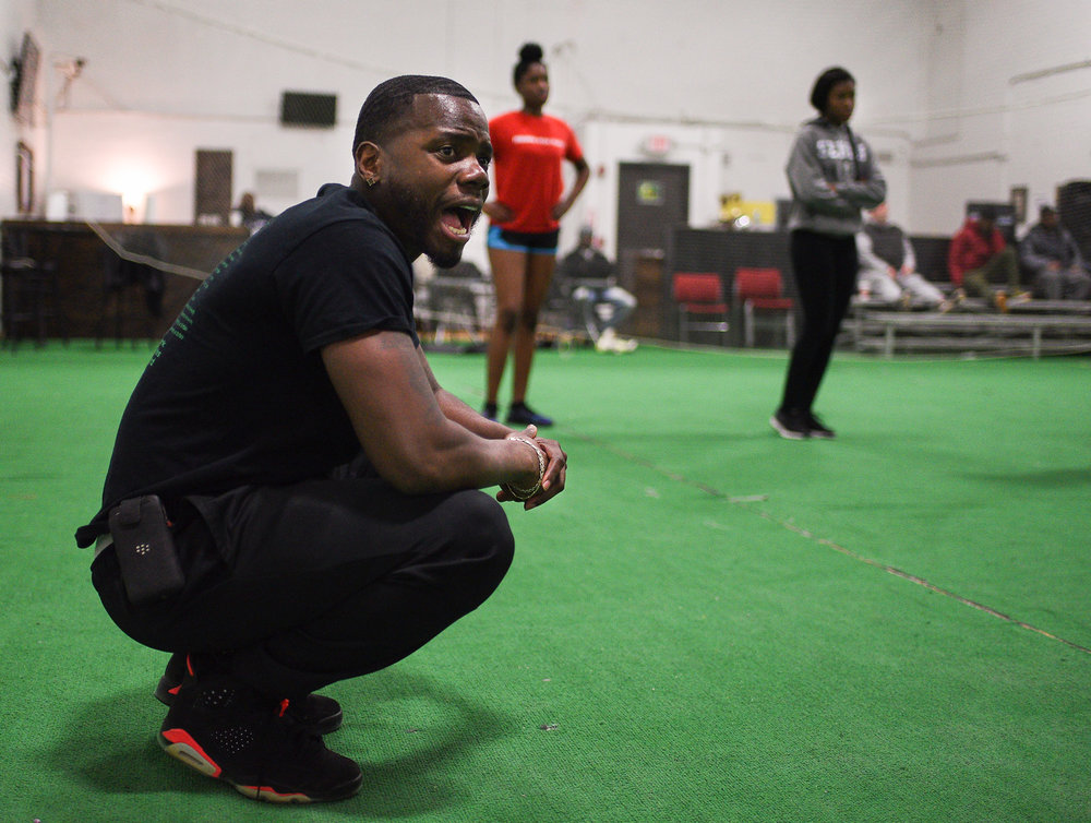 Greg Hopkins yells to athletes during a speed training class at the Lincoln Sports Park in Rochester N.Y. December 10, 2017. Hopkins started the football mentorship program called  Changing the Community, as a way to help athletes of the Rochester area get the opportunities that they deserve.