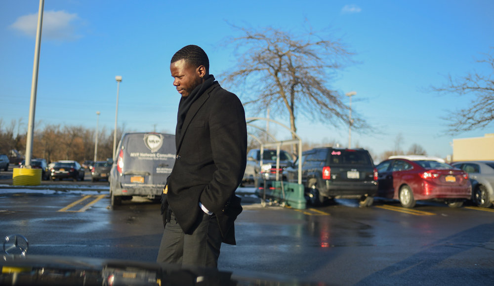Hopkins walks back to his car after visiting a bank in Buffalo N.Y. on Dec. 8, 2017. Hopkins owns and operates a call center based out of Buffalo and he regularly travels between Rochester and Buffalo.