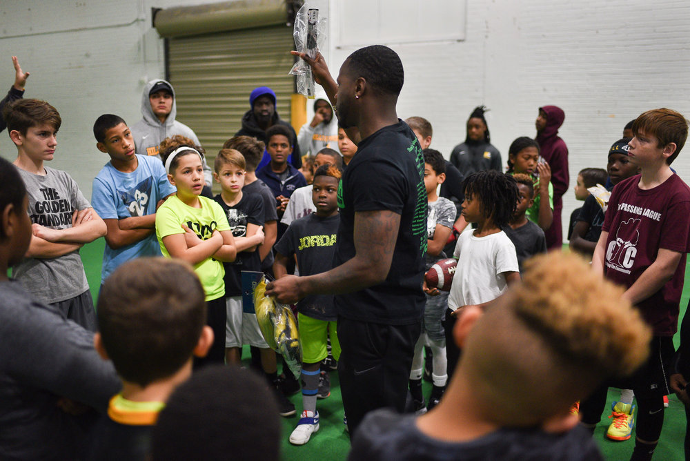 Hopkins addresses a group of athletes that attended the biweekly football training program at the Lincoln Sports Park in Rochester N.Y. on Dec.10, 2017.