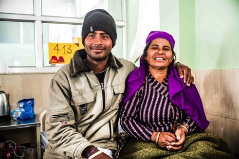 Radhika Dhakal  Radhika Dhakal (50 yrs.) with her son. Radhika married when she was 8 to a 32 yr. old man and gave birth to two children. She developed prolapse when she was 20.