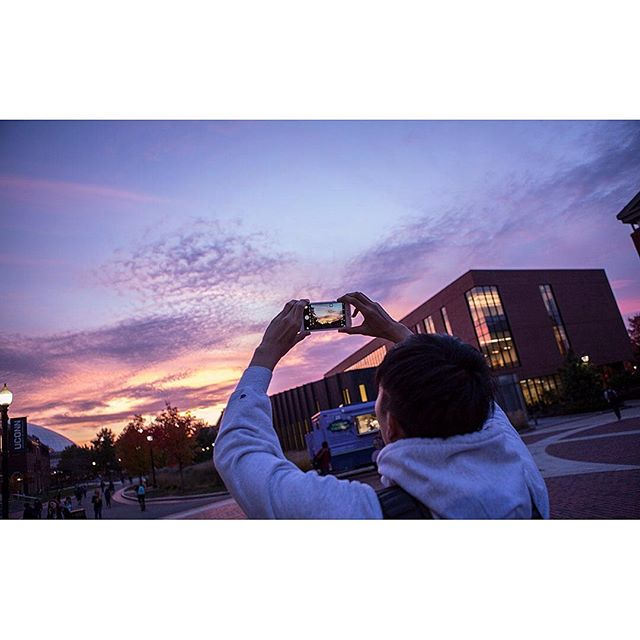 The sun setting on campus as we end our week and look forward to 6 more weeks of winter! ❄️ . . . . #Uconn #storrs #storrsct #gampel #gampelpavilion #fairfieldway #tgif #campuslife #uconnhuskies #photoofphoto #sunset #purplesky #collegestudent #highereducation #educationphotography #highered #groundhogday #6moreweeks #morewinter