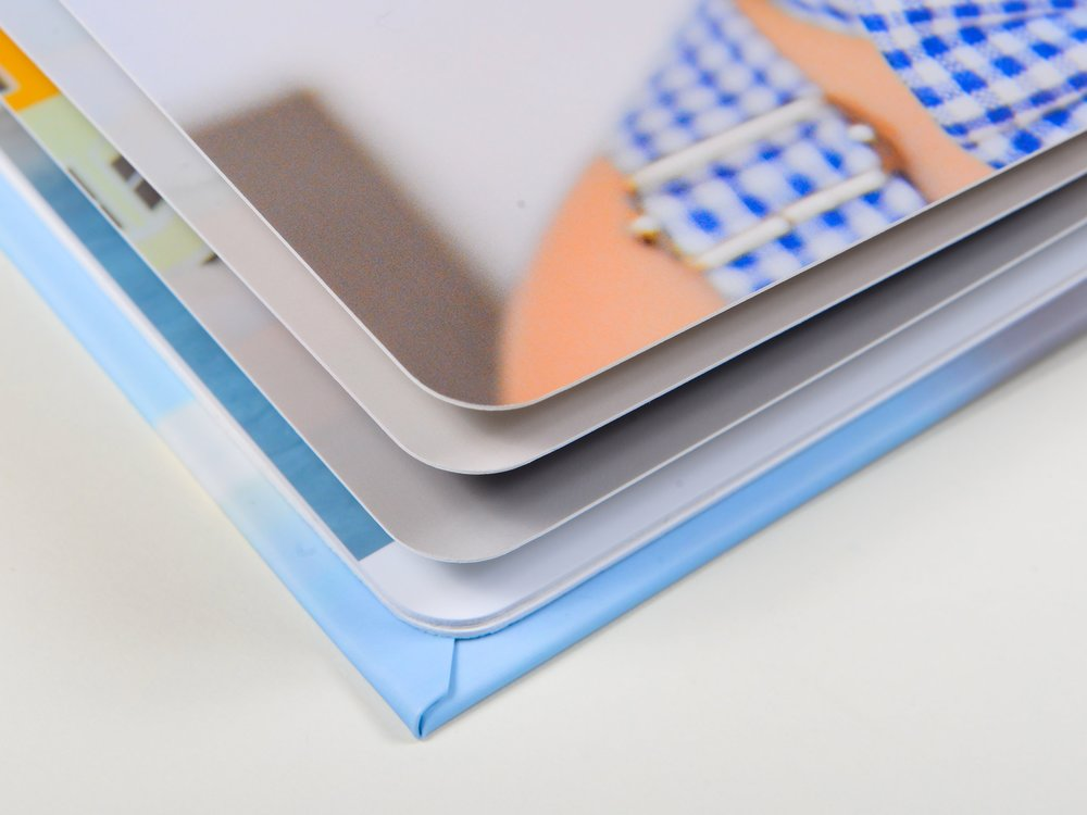 Luxurious Pages - Thick, flush-mount pages with a fine coat of matte lamination for a soft fine art feel. Printed on Kodak Professional Endura Premier Paper for archival quality.Rounded corners add a unique detail.