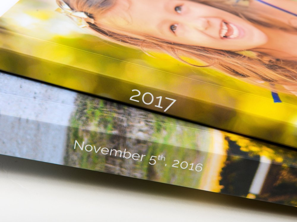 Spine Printing - We'll write the date of your Milestone event or year of your Annual Album on the spine for easy reference.