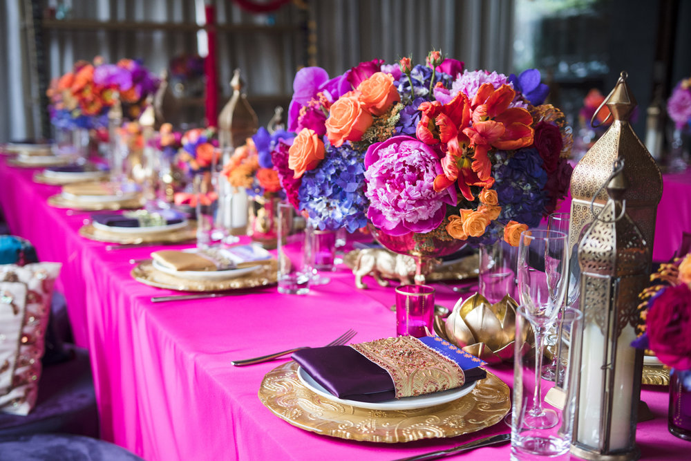 Moroccan+Inspired+Baby+Shower+Party+shades+of+pink+purple+and+orange+flowers+adorned+each+table