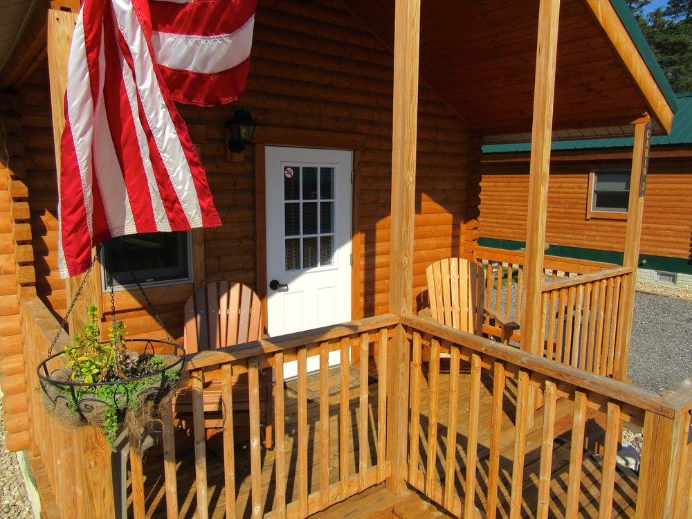 Cabin Porch with Adirondack Chairs
