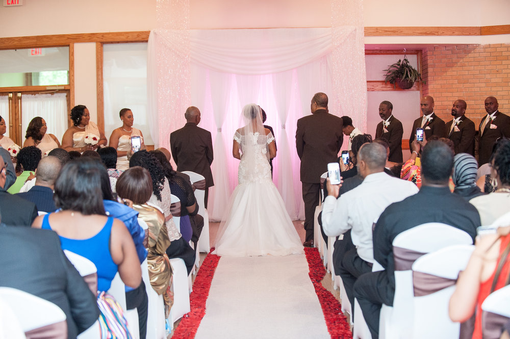 View Down Aisle During Wedding Ceremony with Guests Seated at Cherry Hill Ballroom