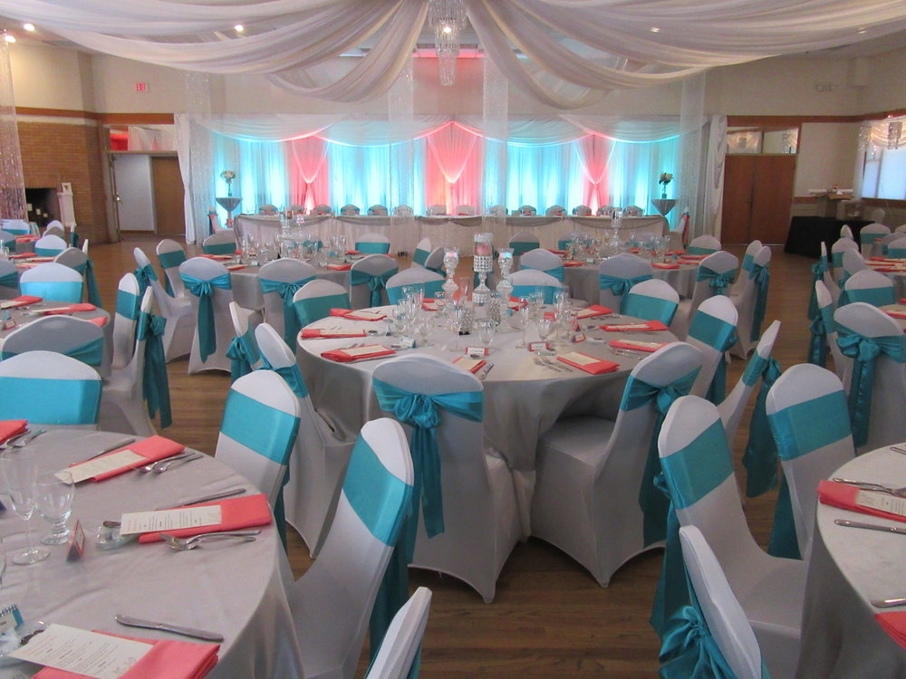 Ballroom Tables and Chairs Decorated with White, Coral, and Turquoise Motif