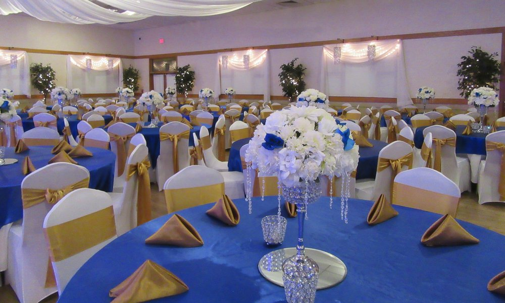 Tables and Chairs Decorated in White, Blue, and Gold at Cherry Hill Ballroom