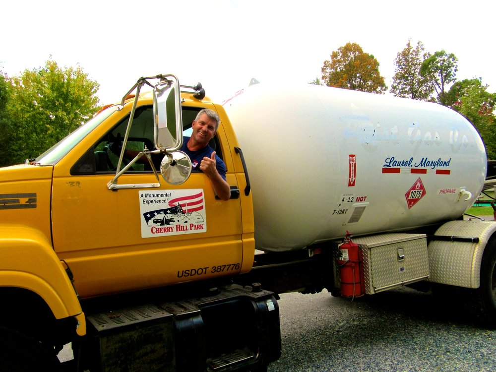 Employee Making Propane Deliveries in Truck at Cherry Hill Park