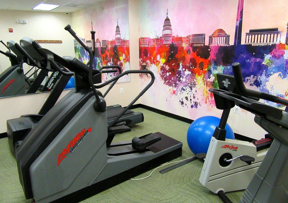 Treadmill, Elliptical, Stairmaster, and Stationary Bike in Cherry Hill Park's Gym
