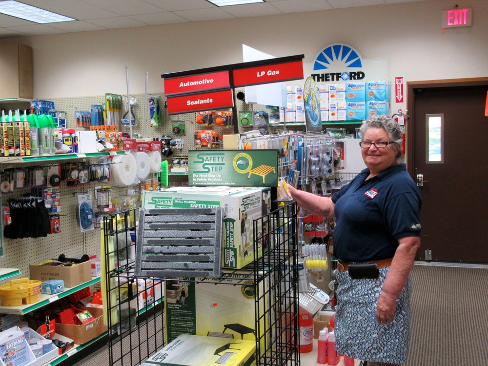 Employee Stocks Shelves at RV Store