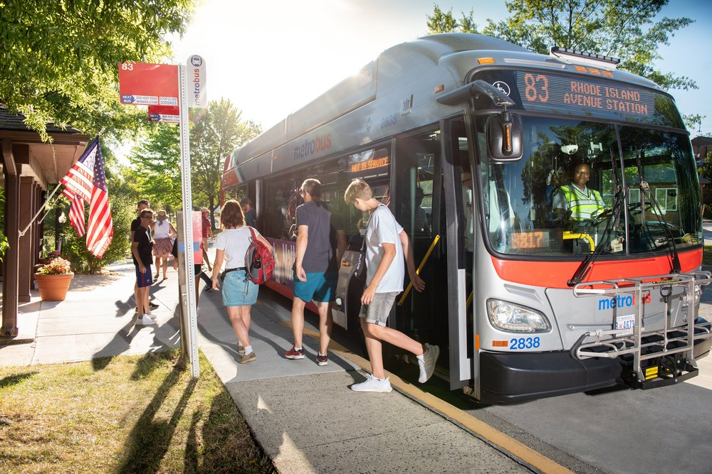 Campers Disembark DC Metrobus from Nearby Metro Station to Cherry Hill Park Bus Depot