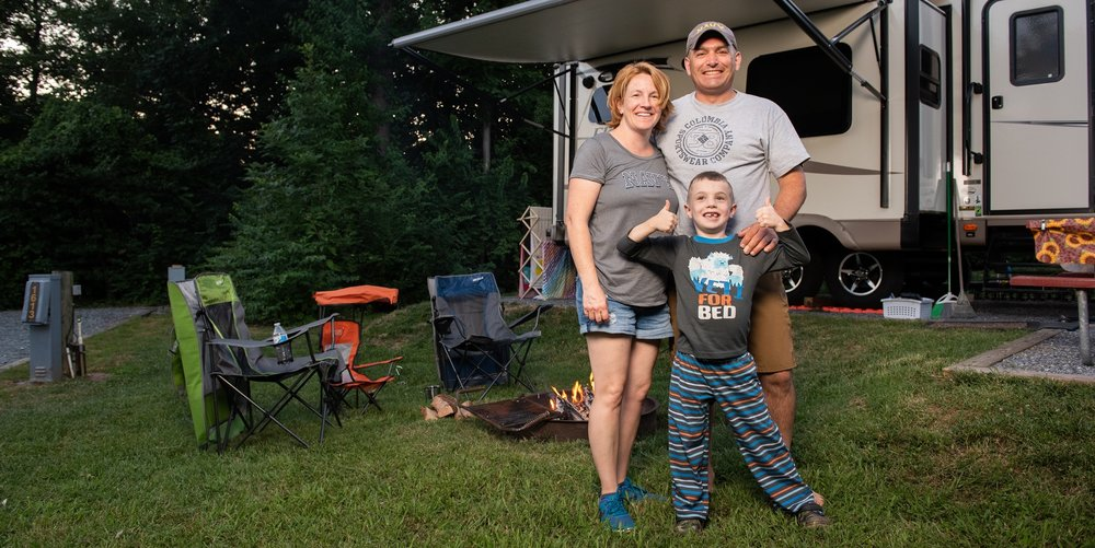 Family Camping at RV Site at Cherry Hill Park