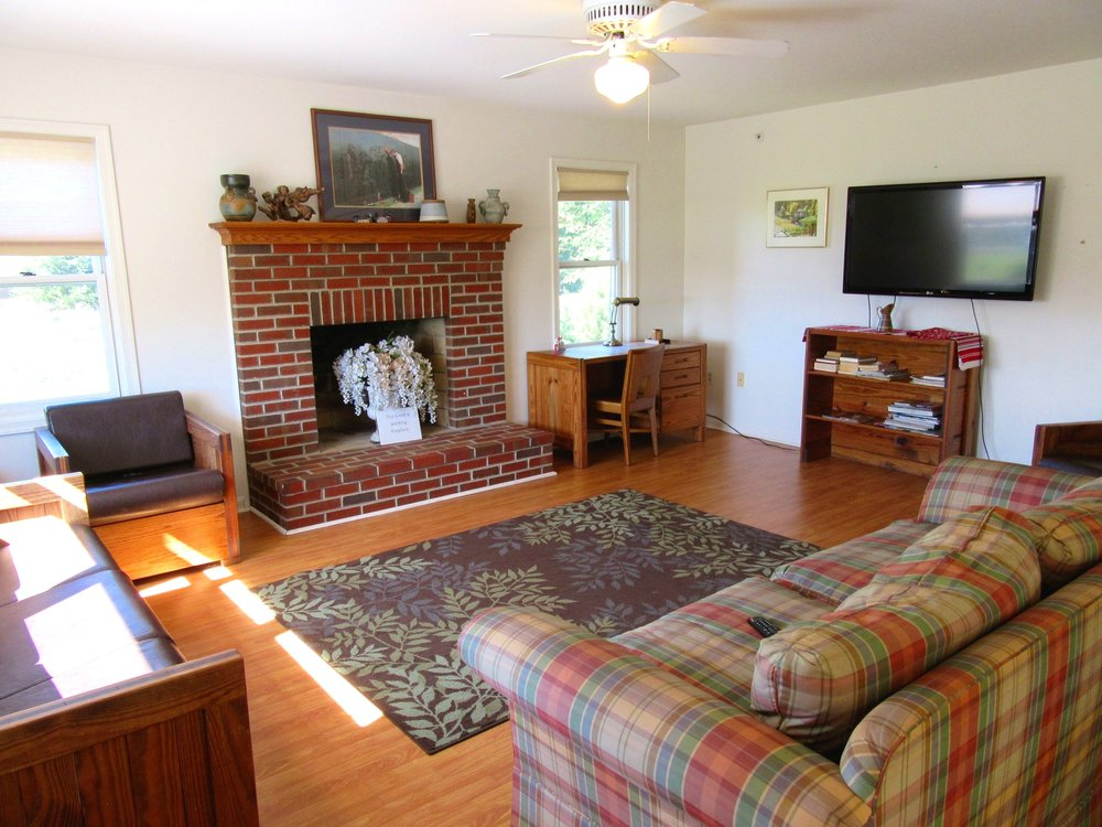 Cottage Living Room with Sofas and Brick Fireplace