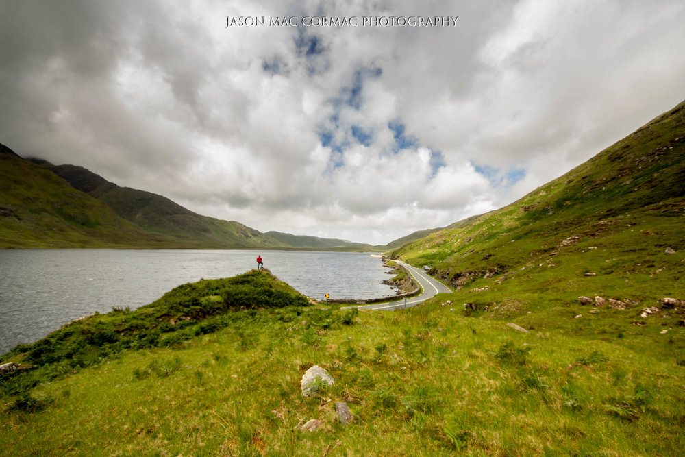 What a perfect place to stand and admire the scenery. Doo Lough County Mayo  Image Details: F8, ISO 100, 1/60. On tripod with timer locked taking repeated shots until i walked to the hill top.