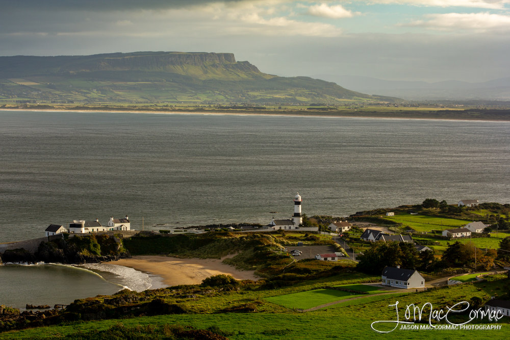 Shrove Lighthouse with Binevenagh mountain in the background.