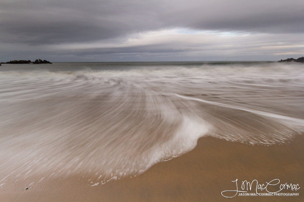 Long Exposure of a second as the waves crashed in and receded.