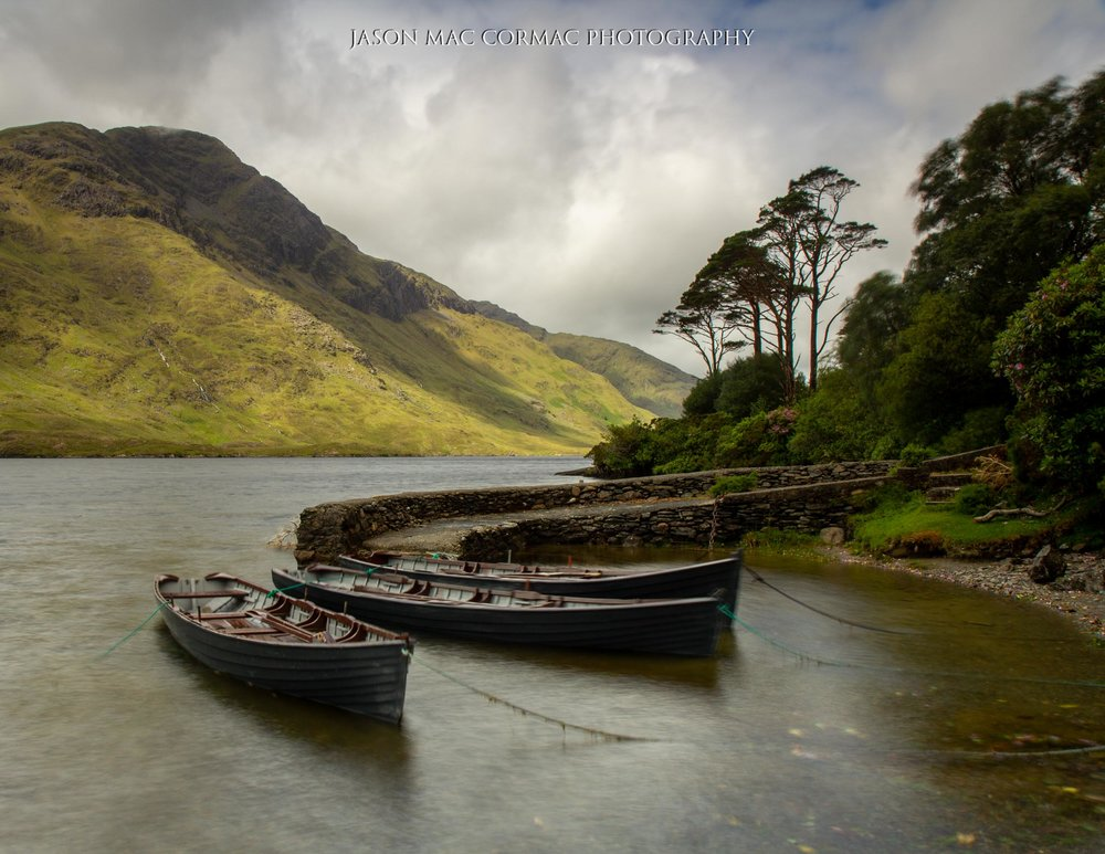 Boats moored at Doo Lough Jetty, Mayo