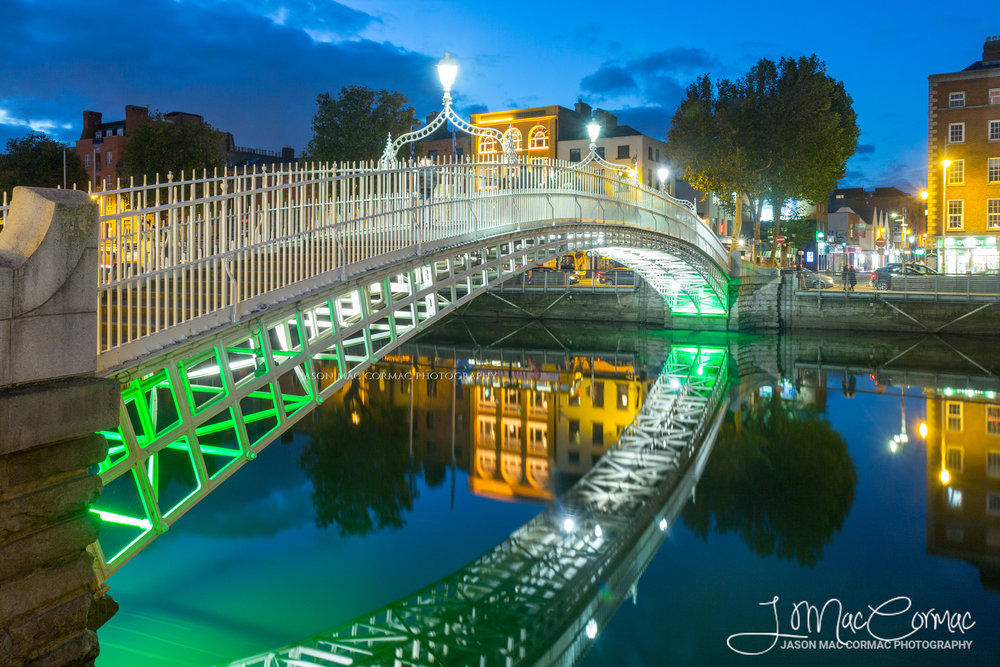 River Liffey acting as a mirror to the beautiful Hapenny Bridge at dusk.
