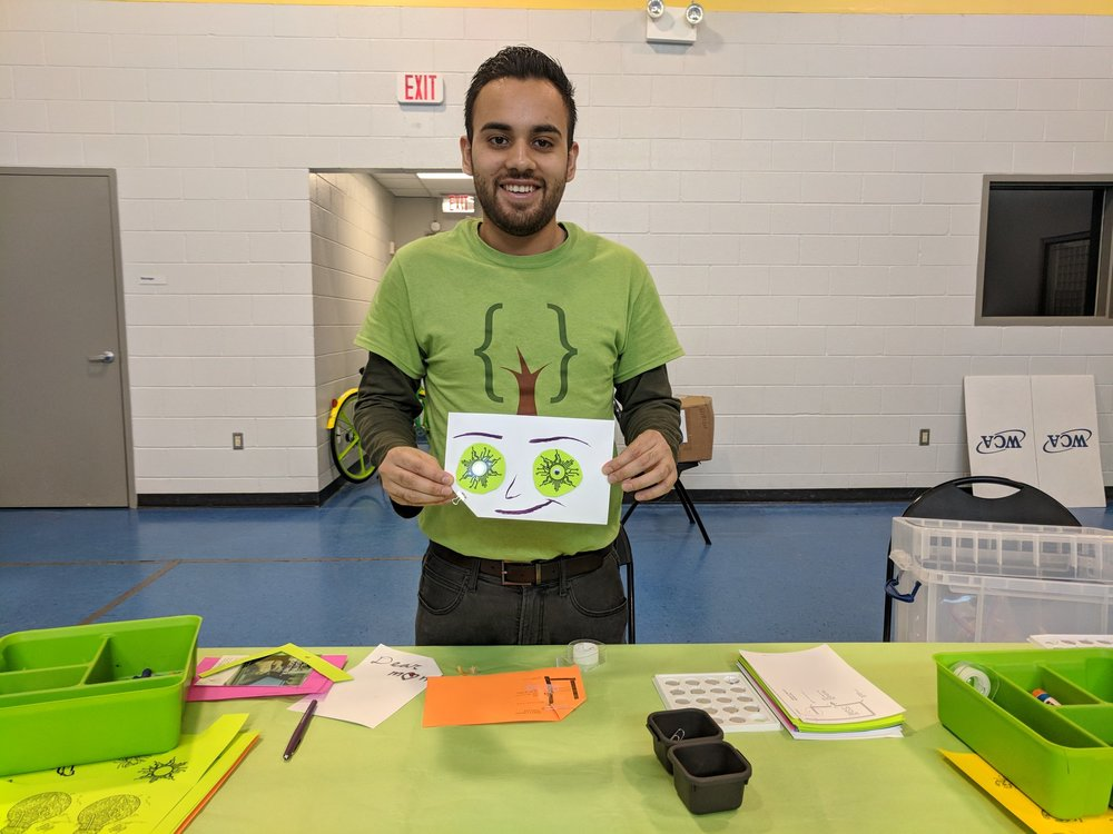 Volunteer and Software Developer Bryan holding up his creation at the one day STEM Camp at Finnigan Park Community Center. July 7th 2018. Courtesy of Wanjun Zhang.