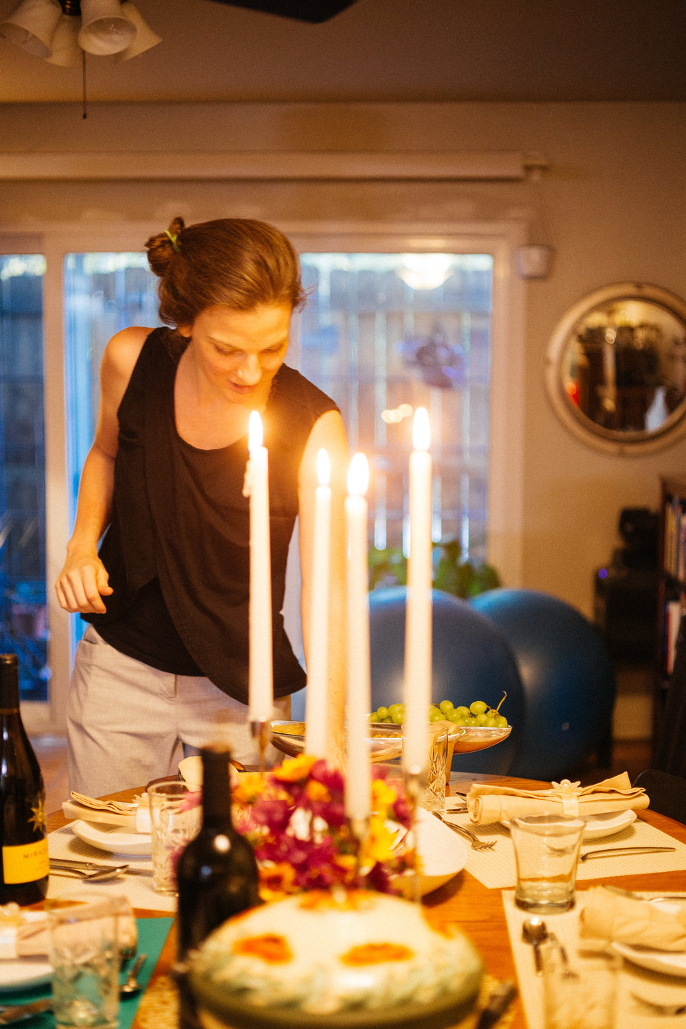 Bonnie, who graciously put together Code Park's team dinner along with Ben, places final touches on the dinner table in her home. Courtesy of Wanjun Zhang. August 24th, 2018.
