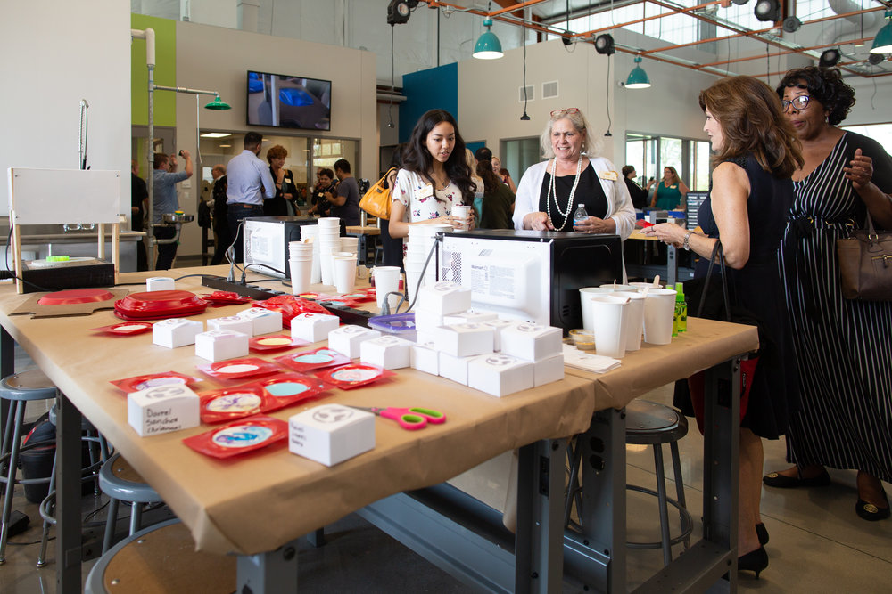 Alandra, Fab Lab Student Ambassador and Code Park Invent to Learn student, talks about the soap-making process at Fab Lab Houston using a vacuum former and a laser-cut mold positive. Courtesy of Wanjun Zhang. September 18th, 2018.