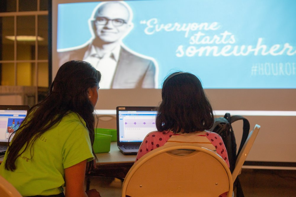 Volunteer Krishna helps students with their Hour of Code activity as part of CS Education week. Leonel Castillo Community Center. Courtesy of Wanjun Zhang. December 3rd, 2018.