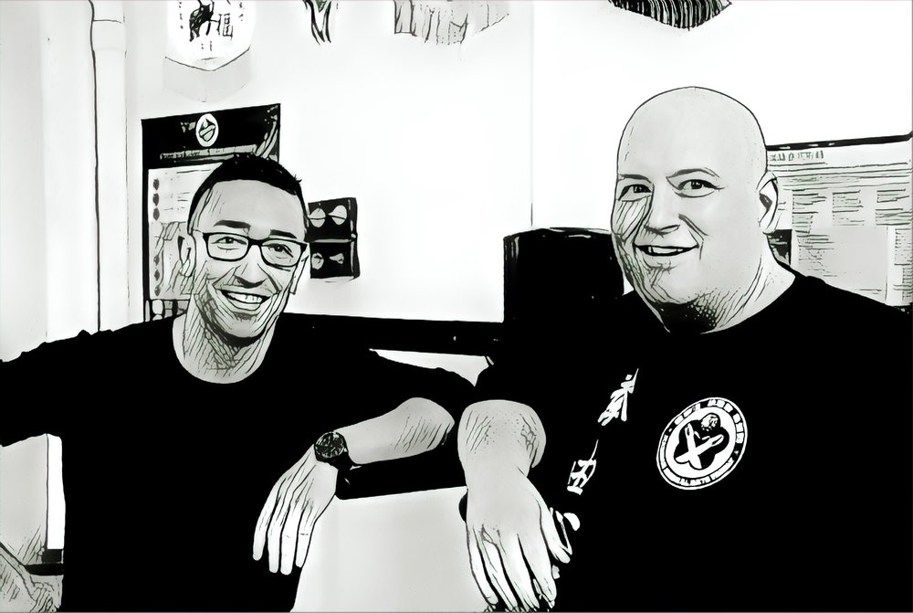 The Dudes of Kung Fu are Alex Richter (the Kung Fu Genius) and BIG Sean Madigan.  This is not an altered photo, they are both black and white comic book characters in real life.