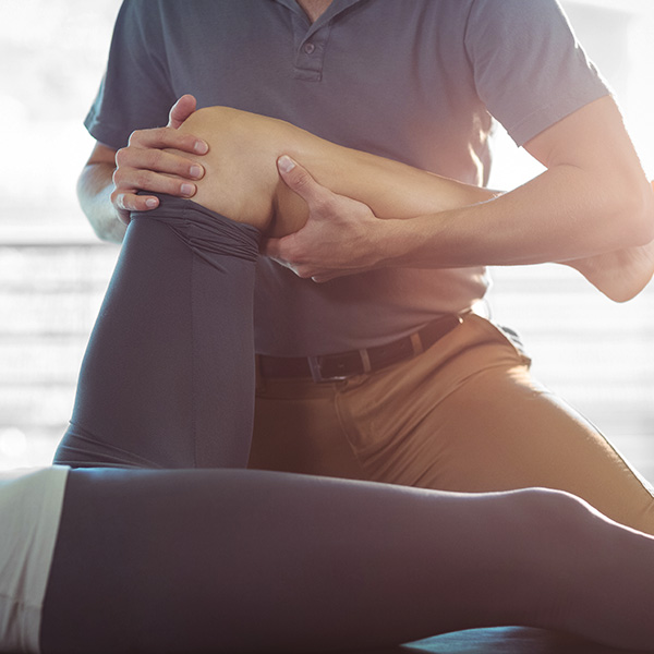 Woman receiving physiotherapy for her leg