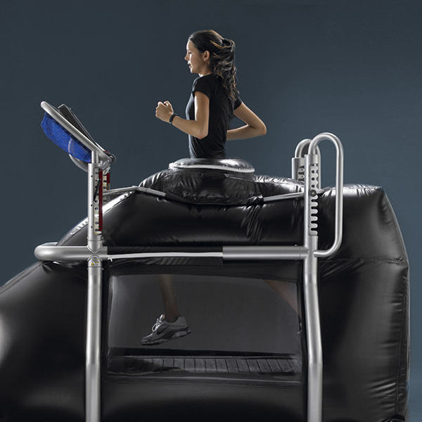 Woman using anti-gravity treadmill