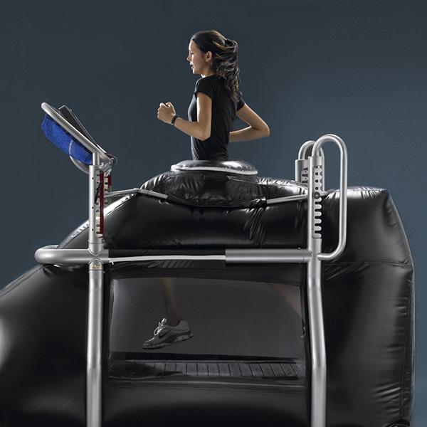 Woman using anti-gravity treadmill