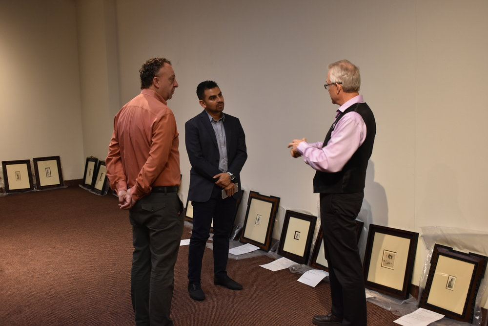 Arts center executive director jim richerson shares a sneak peek of the rembrandt etchings in the white gallery with visiting consul general el salvador manuel castillo and local international businessman jeff fogg.