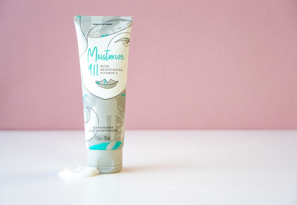 Moisturize 911 Caffeinated Face Moisturizer on a pink background.