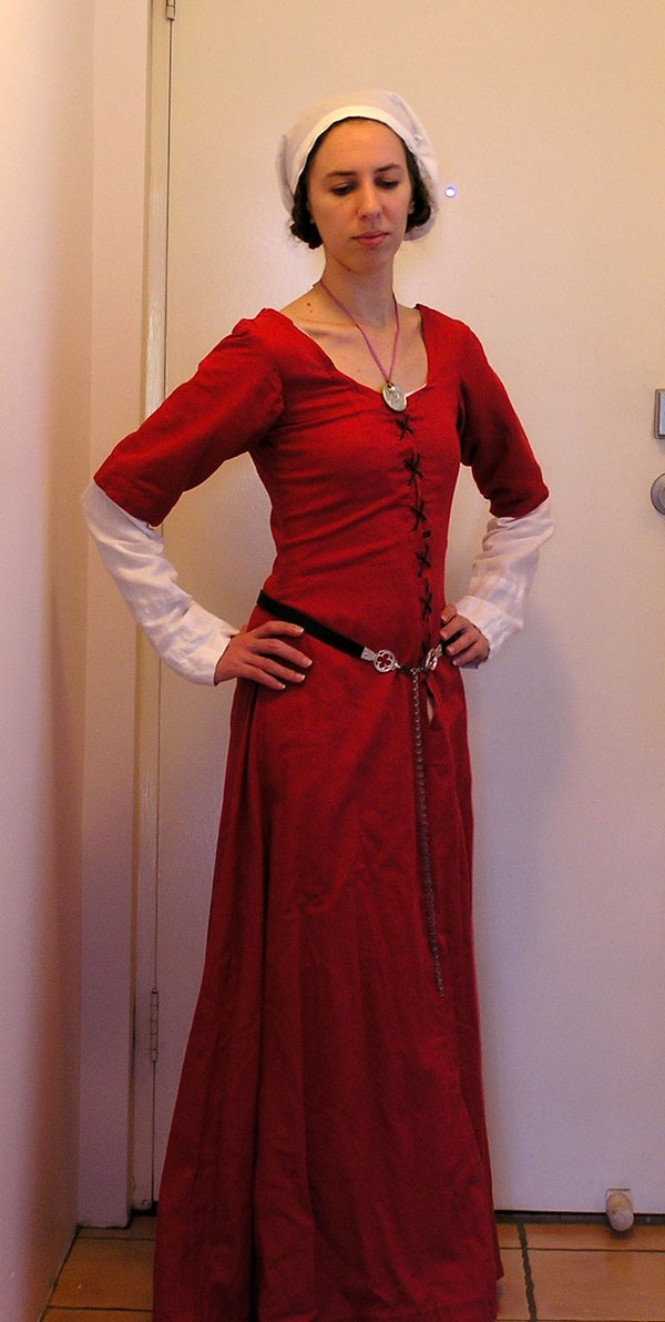 Me in one of my handmade costumes from a few years ago. This is a red short sleeved kirtle in linen, with a linen chemise, and a linen/ cotton head covering (sewn band and ties based on Swiss design)