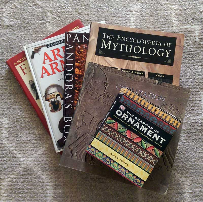 Some of my reference books - covering art objects from museums, mythology with art, ornamentation from Victorian copy books, arms and armour books, and costume books