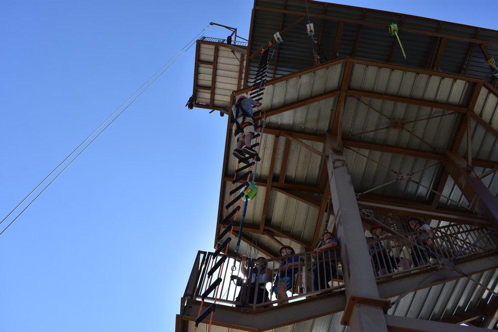 Nate climbing a 45 foot ladder