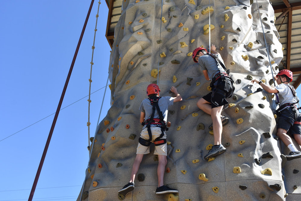 Nate, Logan and Sam rock climbing