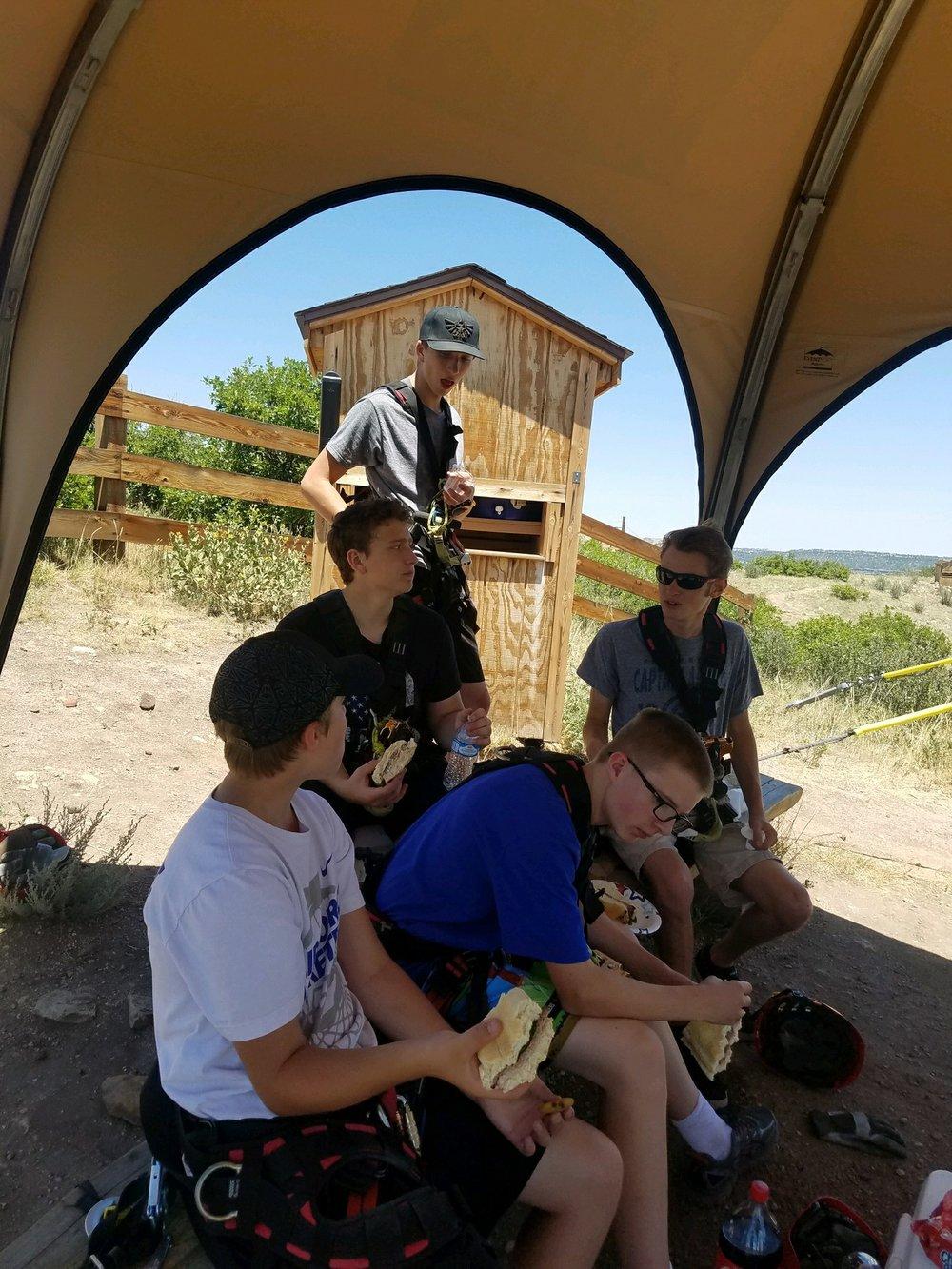 Gavin, Zane, Logan, Todd and Nate eating lunch near Zipline #6