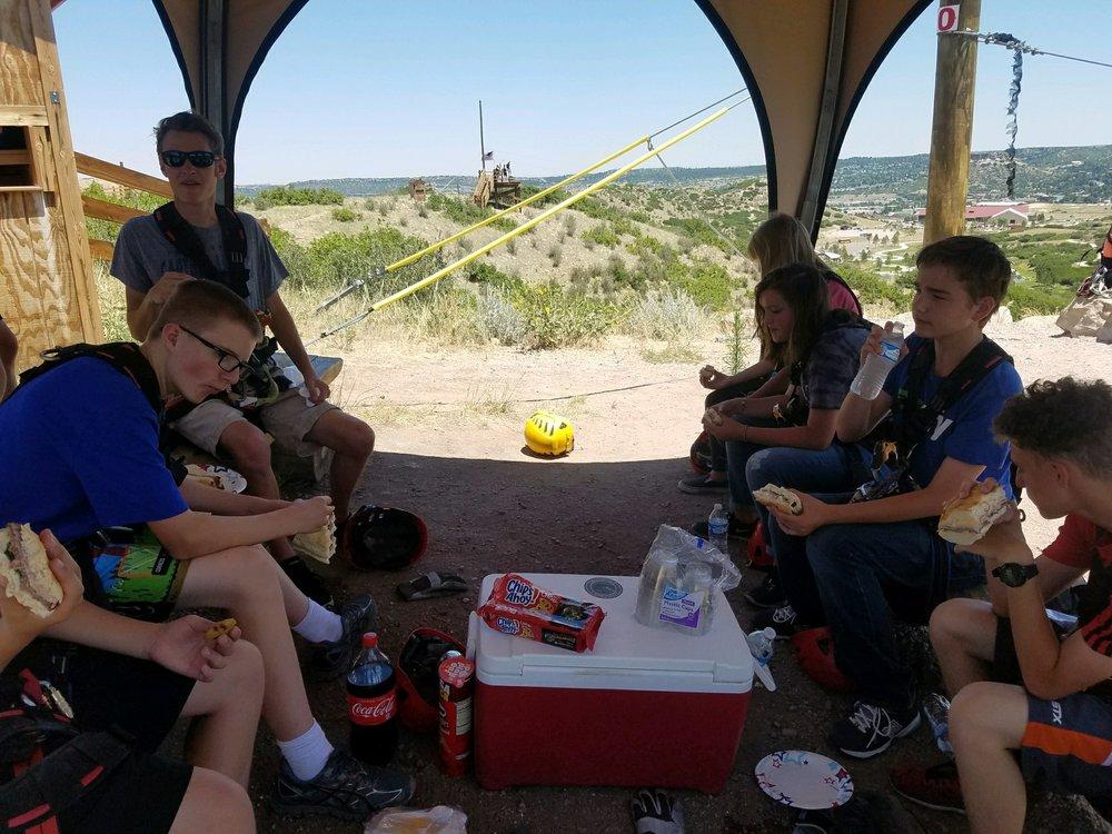 Todd, Nate, Jane, Allie, Trevan and Devin eating lunch near Zipline #6