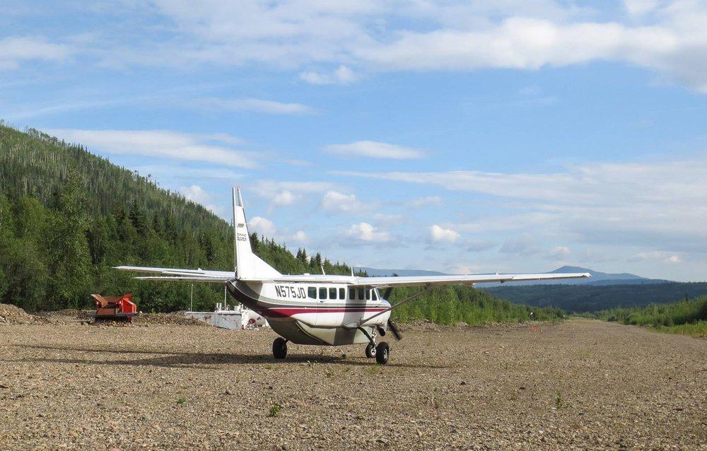 Caravan plane arrives at the gravel runway at Coal Creek Camp bringing the 2014 participants.