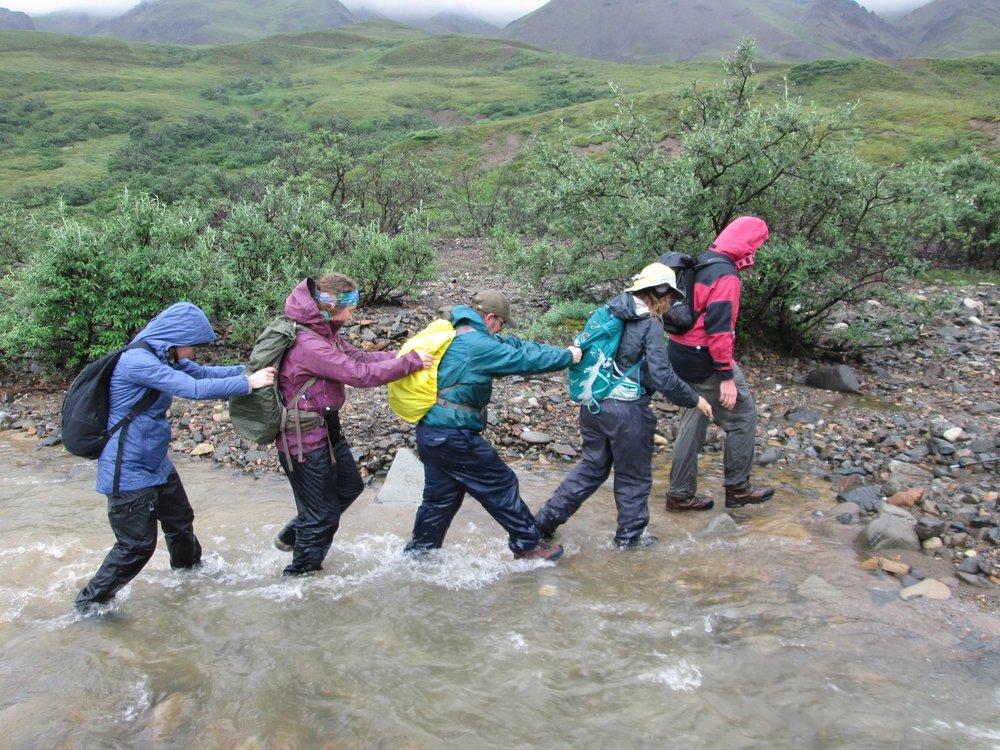 Intrepid 2017 participants practicing good river-crossing technique.