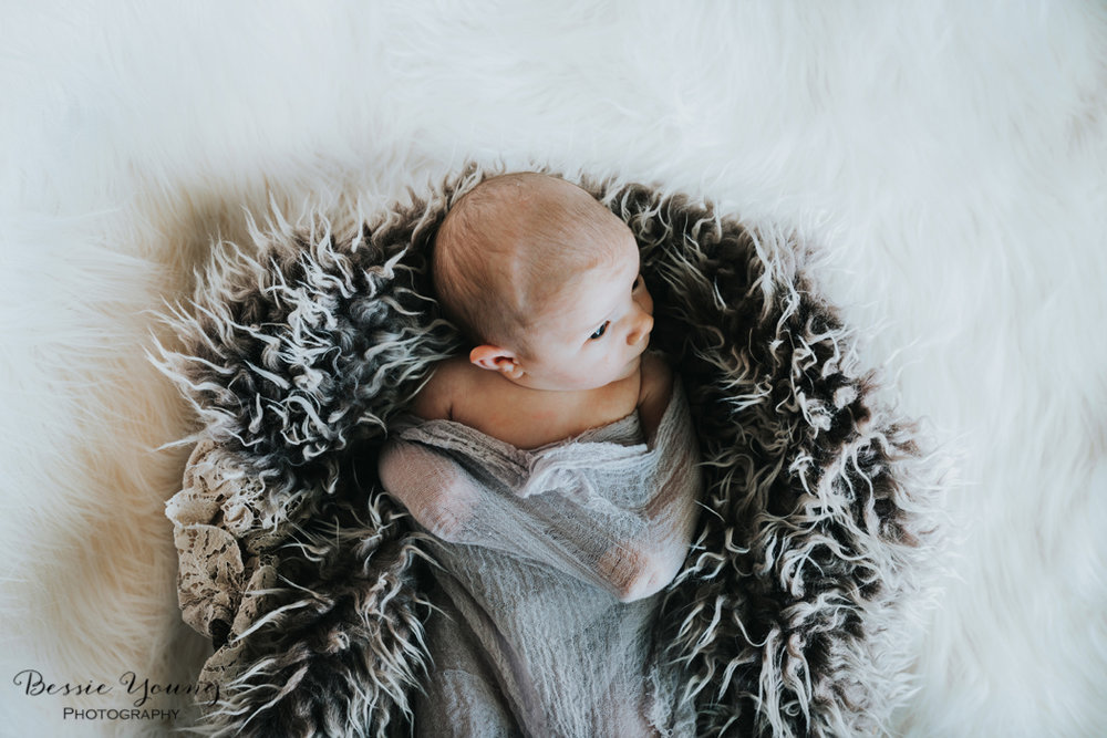Indoor Newborn Portraits photographed by Bessie Young Photography - Brown and white