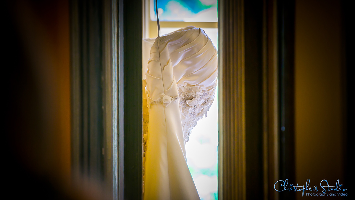 Wedding dress on door at Feast Catering
