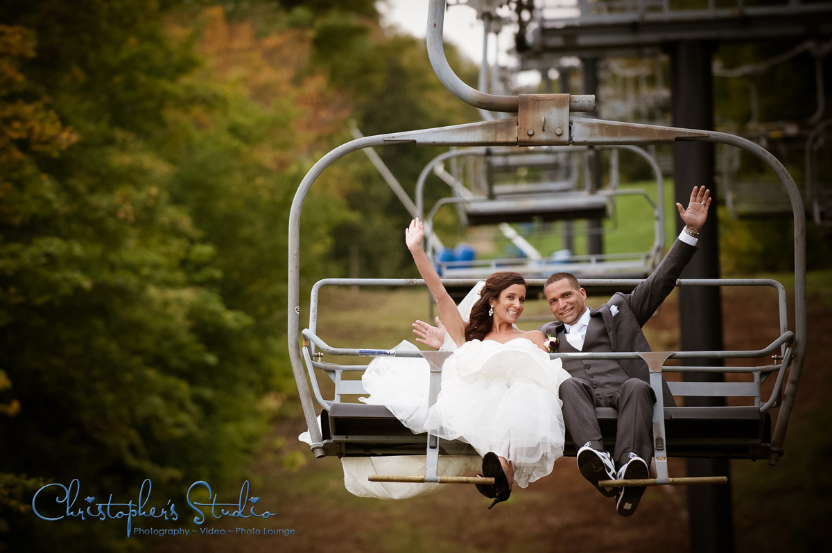 Bride and Groom in Chairlift after ceremony