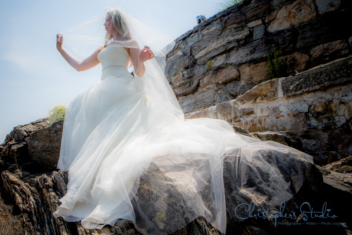 Bride on the rocky shore photo