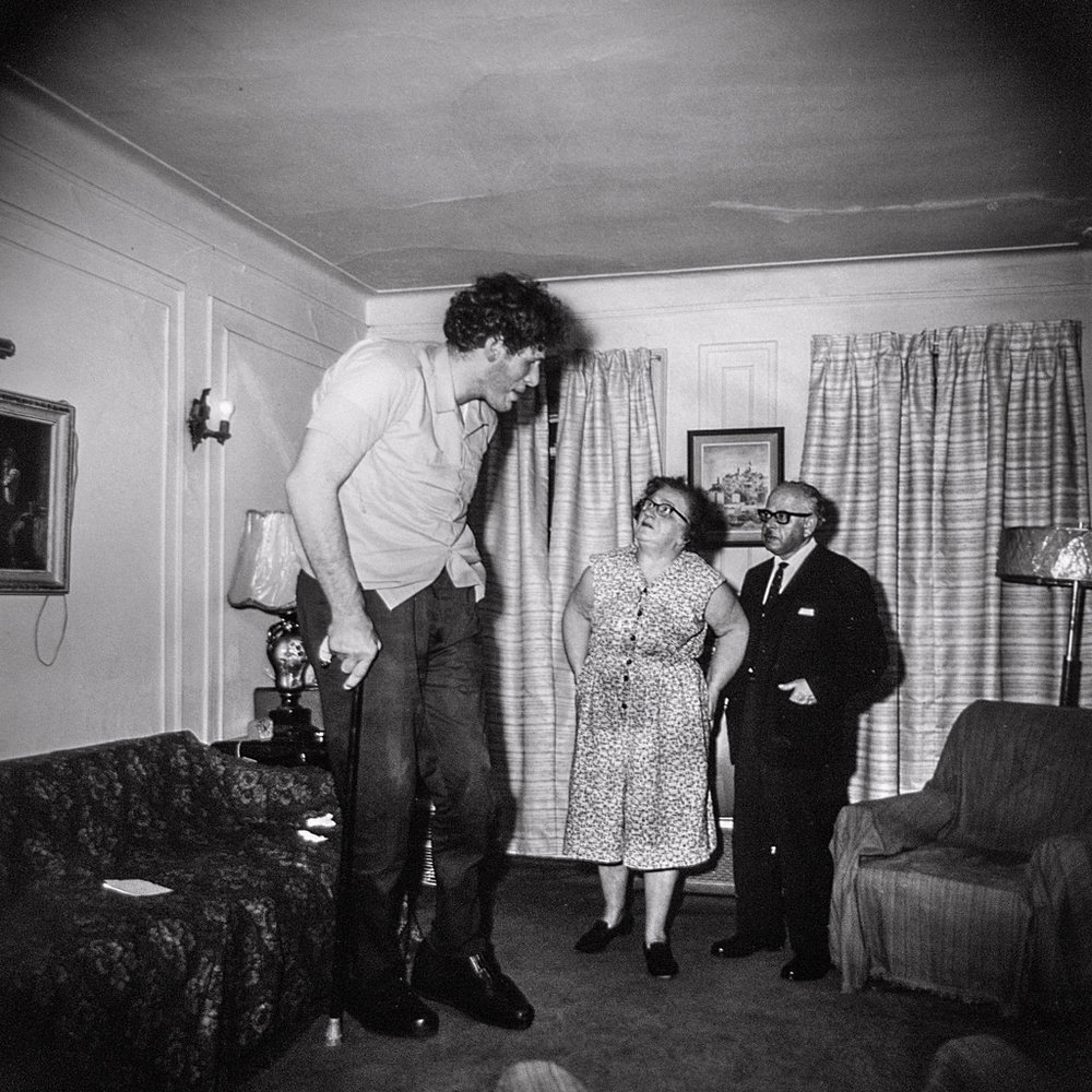 """©1968 estate of Diane Arbus, LLC, A Jewish giant at home with his parents, in the Bronx, N.Y., 1970.   """"Take pictures of what you fear."""" - Diane Arbus"""