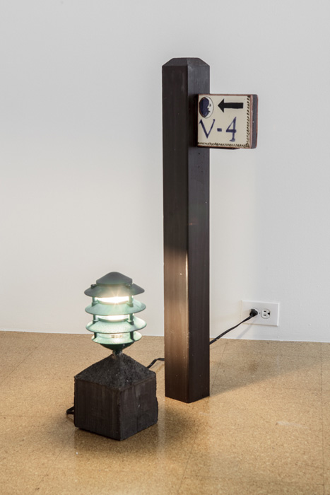 Fiona Connor, Object No. 9, Bare Use (V-4), 2013, mixed media, lamp: 16 x 6 x 6 inches, 40.6 x 15.2 x 15.2 cm, signpost: 36.25 x 11 x 3.75 inches, 92.1 x 27.9 x 9.5 cm